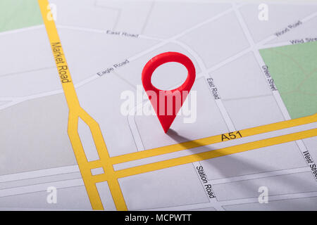 High Angle View Of Navigation Map With Red Pin Pointer - Stock Photo