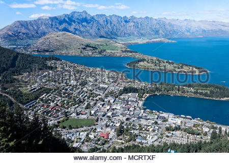 Queenstown sits on Lake Wakatipu with The Remarkables in the background, South Island, New Zealand. - Stock Photo