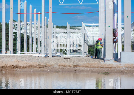 Industrial construction site of new commercial shopping mall. Reinforced concrete piles foundation for the building. Ongoing framing, construction of - Stock Photo