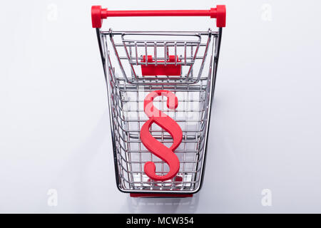 Elevated View Of Shopping Cart With Red Paragraph Symbol - Stock Photo