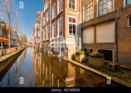Canal along Voldersgracht street, in the old center of Delft - Stock Photo