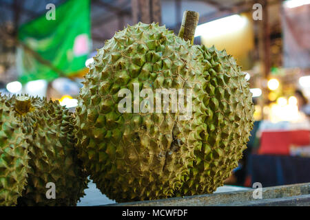 Closeup of some Durian Fruits a street food stall at the weekend market, Phuket, Thailand - Stock Photo