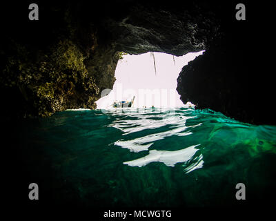 Action cam picture of the entrance of the Emerald cave (mokarot cave) in Ko Muk, Ko Lanta, Thailand. - Stock Photo