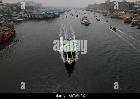Dhaka, Bangladesh. Steamers run through the Buriganga River in Dhaka, Bangladesh on April 17, 2018. Thousands people cross the Buriganga river everyday, which is becoming deadly river as the chemical waste of mills and factories, household waste eventually makes its way into the Buriganga River. © Rehman Asad/Alamy Stock Photo - Stock Photo