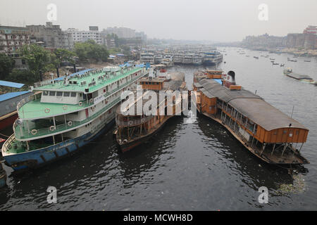 Dhaka, Bangladesh. Steamers (ship) anchored in the Buriganga River in Dhaka, Bangladesh on April 17, 2018. Thousands people cross the Buriganga river everyday, which is becoming deadly river as the chemical waste of mills and factories, household waste eventually makes its way into the Buriganga River. © Rehman Asad/Alamy Stock Photo - Stock Photo