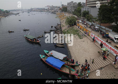 Dhaka, Bangladesh. Boats anchored in the Buriganga River in Dhaka, Bangladesh on April 17, 2018. Thousands people cross the Buriganga river everyday, which is becoming deadly river as the chemical waste of mills and factories, household waste eventually makes its way into the Buriganga River. © Rehman Asad/Alamy Stock Photo - Stock Photo