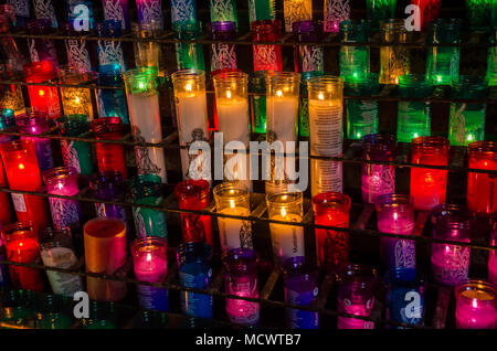 Candles burning at the abbey at Montserrat in Saint in memory of loved ones. - Stock Photo