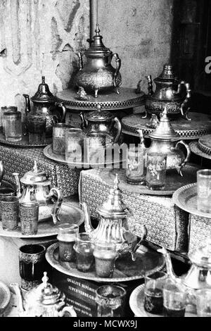 Old fashioned picture of traditional tin cans and tea cups at the old souk in Casablanca, Morocco