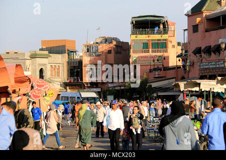 Crowd of people strolling across the famous Jemaa el-Fnaa square in Marrakesh, Morocco - Stock Photo