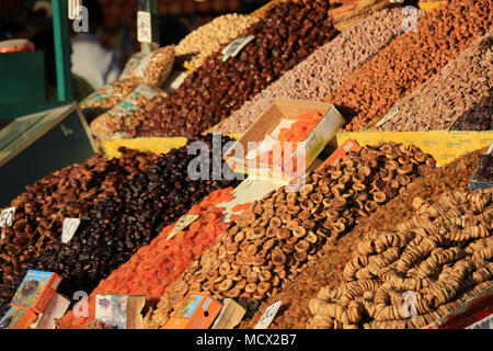 Dried dates, apricots and other fruits on display at the market at the famous Jemaa el-Fnaa square in Marrakesh, Morocco - Stock Photo