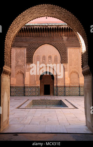 Entrance to the colonnade around the inner courtyard of the Ben Youssef Madrasa (Qur'anic school) in Marrakesh, Morocco - Stock Photo