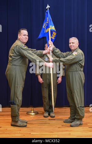Pennsylvania Air National Guardsman Lt.Col. Bryan O'Neill (right) receives the guidon from Col. Gilbert Patton, 171st Operations Group Commander (left), as O'Neill takes command of the 146th Air Refueling Squadron March 2, 2018 at the 171st Air Refueling Wing near Pittsburgh. (U.S. Air National Guard photo by Senior Master Sgt. Shawn Monk) - Stock Photo