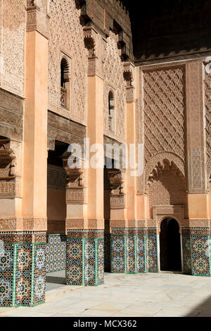 Colonnade around the inner courtyard of the Ben Youssef Madrasa (Qur'anic school) in Marrakesh, Morocco - Stock Photo