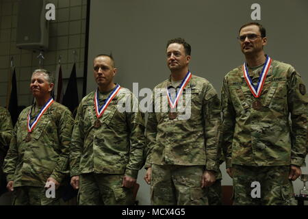 Broze medal winners of the Men's Relay race for the 2018 Chief, National Guard Bureau Biathlon Championships this week in Soldier Hollow, Utah. From the Utah Army National Guard, Sgt. Maj. Shawn Blanke, Staff Sgt. Jeremy Teela, Chief Warrant 3 Eric Kreitzer, and Maj. Dan Morken. - Stock Photo