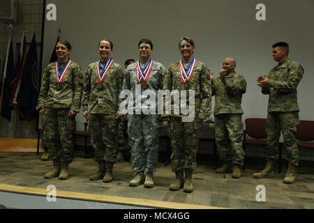 Gold medal winners of the Women's Patrol race for the 2018 Chief, National Guard Bureau Biathlon Championships this week in Soldier Hollow, Utah. From the Utah Army National Guard, Sgt. Samantha Miller, Staff Sgt. Ty'Lene Puro, 1st Lt. Rebecca Doucette, and Cpt. Barb Blanke. - Stock Photo