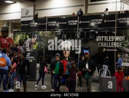 Attendants of the Central Intercollegiate Athletic Association (CIAA) Fan Festival participate in the battles won challenge at the Charlotte Convention Center, Charlotte, North Carolina, on March 3, 2018. The Marines took part in the Fan Festival at the CIAA to spread awareness and inform others of the opportunities the Marine Corps can provide. The Fan Festival assists recruiters by offering them different tools to reach students across the state. (U.S. Marine Corps photo by Lance Cpl. Jack A. E. Rigsby) - Stock Photo