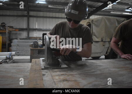 KWAJALEIN, Marshall Islands (March 1st, 2018) Builder Constructionmen Jessika Corwin assigned to Naval Mobile Construction Battalion (NMCB) 11, Construction Civil Action Detail Marshall Islands, uses a circular saw in support of an upcoming project. NMCB-11 is forward deployed to execute construction, humanitarian and foreign assistance, and theater security cooperation in the 7th Fleet area of operations. (US Navy photo by Construction Electrician 2nd Class Joshua Zapien) - Stock Photo