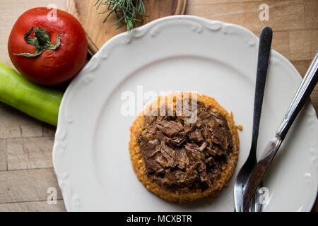 lamb meat with bulgur rice pilav or pilaf - Stock Photo