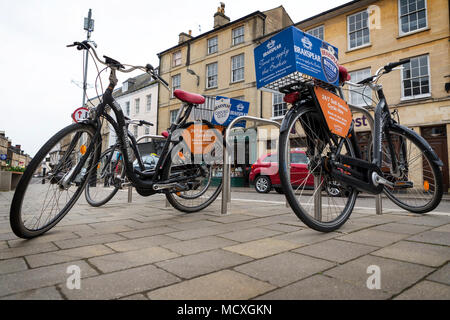 Donkey bikes chained to bike posts in Cirencester's town centre ready for hire on 07 April 2018 - Stock Photo