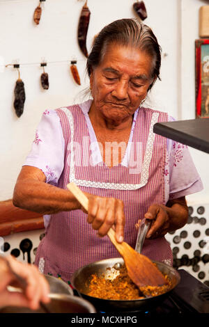 Grandmother of Chef José Luis Diaz cooking enchiladas de san pedro totolapam (meat -illed tortillas with chile sauce) Restaurante Chilhuacle Rojo,  Oa - Stock Photo