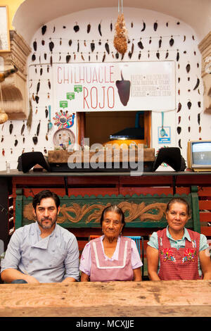 Chef José Luis Diaz with his mother and grandmother  Restaurante Chilhuacle Rojo,  Oaxaca City, Oaxaca, Mexico - Stock Photo