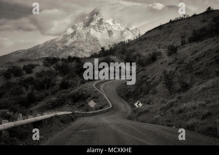 Paine Massif mountains  and road at sunrise . Torres del Paine National Park, Chile, Patagonia - Stock Photo