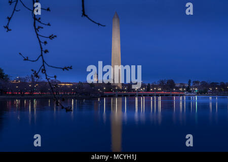 Washington DC. USA - March 24, 2018. Beautiful view of Washington Monument in twilight scene with reflection in the water - Stock Photo