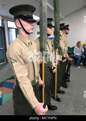 U.S. Marines with the Security and Emergency Services color guard team prepare to perform in a ceremony for 'Project AIM High' (academic achievement, innovation, mental health) at Bonsall West Elementary School March 7, 2018. Bonall West received a grant from the Department of Defense Education Activity that will allow the school to improve learning through STEM (science, technology, engineering and math) programs. (U.S. Marine Corps photo by Lance Cpl. Brooke Woods) - Stock Photo