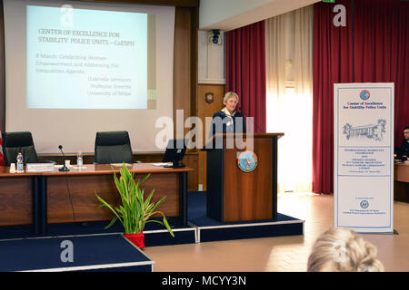 Mrs. Gabriella Venturini, professor emerita of international law at the University of Milan, addresses dignitaries and guests from Europe, Africa, Italy, and the U.S., during the opening ceremony of the 8th Gender Protection in Peace Operations Course at the Center of Excellence for Stability Police Units (CoESPU) in Vicenza, Italy, Mar. 8, 2018. The event brought together military and civic leaders from the local community to celebrate International Women's Day. (U.S. Army Photo by Paolo Bovo) - Stock Photo