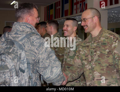 Yavoriv, Ukraine – Maj. Gen. Anthony German, the New York Adjutant General greets Warrant Officer Robert Taylor during a visit to the Yavoriv Combat Training Center here, Mar. 9. Taylor, a Volney, N.Y. native, is stationed in Ukraine along with more than 220 New York Army National Guard Soldiers where they are mentoring the Ukrainian Army as it strives toward its goal of attaining NATO interoperability. (U.S. Army photo by Sgt. Alexander Rector) - Stock Photo