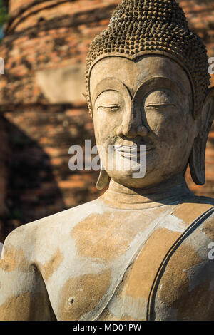 Old cement Buddha image in Autthaya Buddhist ruined temple, travel destination - Stock Photo