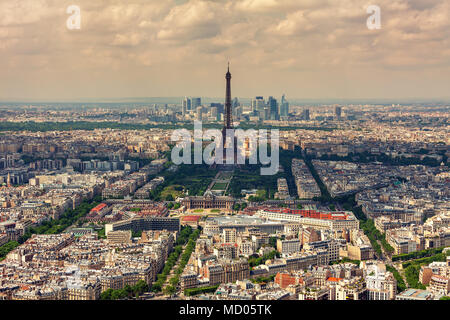 Aerial view of Parisian skyline, Eiffel Tower and La Defense district on background as seen from Montparnasse Tower in Paris, France. - Stock Photo