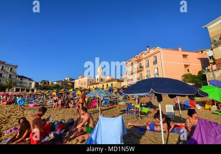 Santa Maria di Castellabate, Campania region, Italy August 15 2016. The beach in the center of the village with houses close to the sea. - Stock Photo