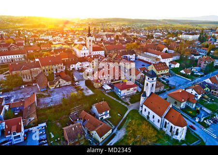 Colorful sunset above medieval town of Krizevci aerial view, Prigorje region of Croatia - Stock Photo