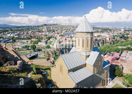 Tbilisi, Georgia : Tbilisi cityscape as seen from the Narikala fortress with the church of st. Nicholas in foreground. - Stock Photo