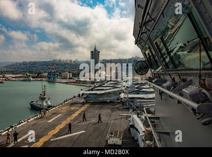 180314-N-JS726-0016 HAIFA, Israel (March 14, 2018) The Wasp-class amphibious assault ship USS Iwo Jima (LHD 7) arrives in Haifa, Israel. Iwo Jima is homeported in Mayport, Fla., and is conducting naval operations in the U.S. 6th Fleet area of operations. (U.S. Navy photo by Mass Communication Specialist 1st Class David Holmes/Released) - Stock Photo