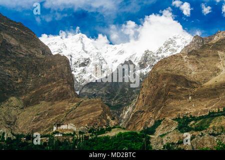 Baltit fort in mountains background, Karimabad, Hunza Valley, Gilgit-Baltistan region, Pakistan - Stock Photo