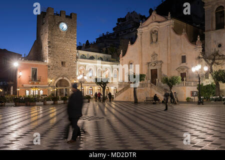 Piazza IX Aprile square, San Giuseppe church and Clock Tower in Taormina, Sicily. - Stock Photo