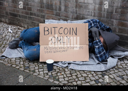 Beggar Sleeping On Street With Bitcoin Only Text On Cardboard - Stock Photo