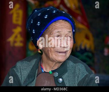 Woman from the Bai Ethnic Minority: Wase Village, Yunnan, China. An estimated 1,240,000 of the Bai speak the Bai language. - Stock Photo