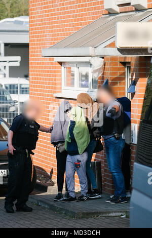 18 April 2018, Rastatt, Hanover: Police forces leading women from a house in the district of Anderten. The police is cracking down on organized crime in a large-scale, nationwide raid starting Wednesday morning. According to the German police in Stuttgart, the focus lies on forged visas, human trafficking, pimping, and forced prostitution of Thai women. (Faces are blurred for legal reasons) Photo: Ole Spata/dpa - Stock Photo