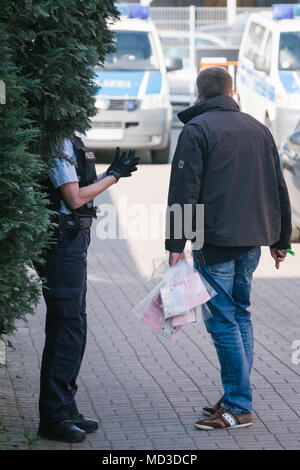 18 April 2018, Rastatt, Hanover: Police forces securing evidence in the district of Anderten. The police is cracking down on organized crime in a large-scale, nationwide raid starting Wednesday morning. According to the German police in Stuttgart, the focus lies on forged visas, human trafficking, pimping, and forced prostitution of Thai women. (Faces are blurred for legal reasons) Photo: Ole Spata/dpa - Stock Photo