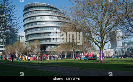London, UK. 18 April, 2018. London wakes up to warm summer weather and blue skies. A Bollywood film crew shooting scenes at Potters Field Park adjacent to City Hall. Credit: Malcolm Park/Alamy Live News. - Stock Photo