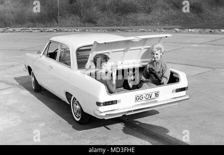 On 05.02.1963 the new Opel 'Rekord' in Russelsheim is officially presented. The picture shows two women sitting in the trunk of the new Opel to demonstrate its spaciousness. | usage worldwide