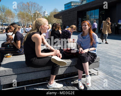 London, 18th April 2018. Workers make the most of the 20 degree plus temperatures on their lunch break in London Bridge (c) Paul Swinney/Alamy Live News - Stock Photo