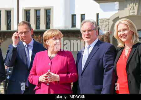 Bad Schmiedeberg, Germany - April 18, 2018: German Chancellor Angela Merkel has Saxony-Anhalt's Prime Minister Reiner Haseloff explain the city of Bad Schmiedeberg to her. The East German prime ministers are meeting in the spa town. Credit: Mattis Kaminer/Alamy Live News - Stock Photo