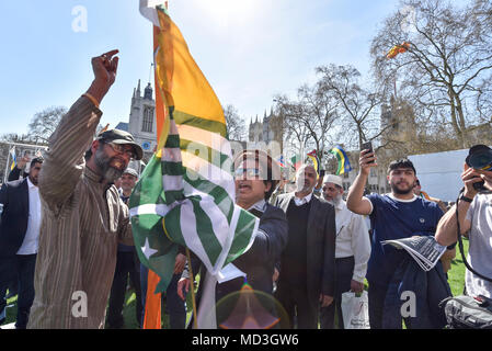 London, UK.  18 April 2018.  The Indian flag, one of many Commonwealth flags flying in Parliament Square, is torn down by Kashmiri and Siki demonstrators in protest against the regime of Indian Prime Minister Narendra Modi.  Sikhs, Kashmiri muslims and other groups all had their own message against PM Modi who is visiting London to take part in the Commonwealth Heads of Government 2018 summit. Credit: Stephen Chung / Alamy Live News - Stock Photo