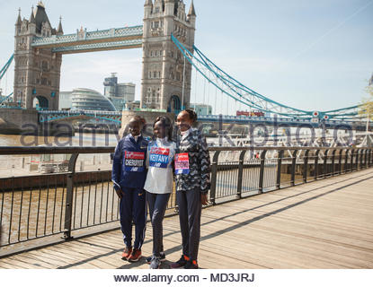 Tower Hotel, London, UK. 18th April 2018 . (L to R)  Vivian Cheruiyot (KEN) , Mary Keitany (KEN) and Gladys Cherono (KEN) during a press photocall in preparation to the Virgin Money London Marathon. Credit: Wamaitha Ng'ang'a/Alamy Live News. - Stock Photo