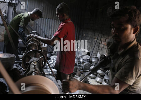 Dhaka, Bangladesh. 18th Apr, 2018. Bangladeshi workers polish silver dishes on a hazard condition for low wage in a workshop at Dhaka. All age's worker work on this kind of small industry on very difficult condition, without any safety guard for low wages. Credit: Md. Mehedi Hasan/ZUMA Wire/Alamy Live News - Stock Photo