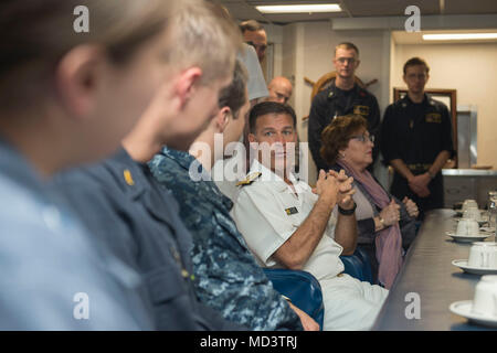 180313-N-OI558-1095 DOHA, Qatar (March 13, 2018) Vice Adm. Chris C. Aquilino, commander, U.S. Naval Forces Central Command, speaks during in the wardroom during his visit aboard the Arleigh Burke-class guided-missile destroyer USS Sampson (DDG 102). Sampson is deployed with the Theodore Roosevelt Carrier Strike Group to the U.S. 5th Fleet area of operations in support of maritime operations to reassure allies and partners and preserve the freedom of navigation and the free flow of commerce in the region. (U.S. Navy photo by Mass Communication Specialist 3rd Class Chanel L. Turner/Released) - Stock Photo